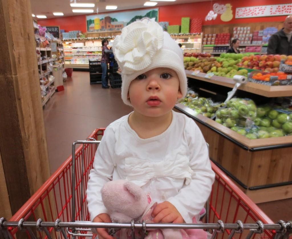 Isabella in the cart at Trader Joe's