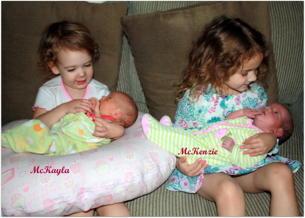 four girls older two looking at babies 2