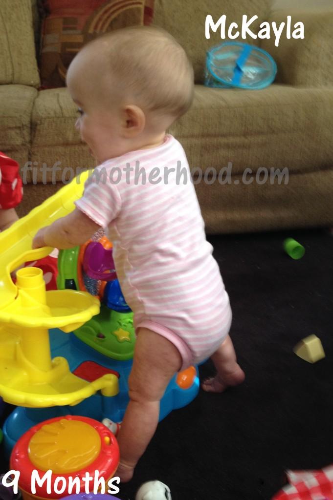 9 months - mckayla standning back