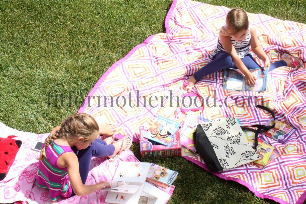 july 2016 girls reading outside