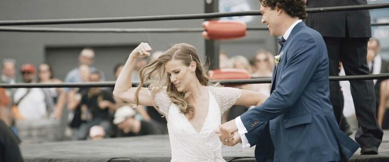 bride and groom posing at wresting tournament