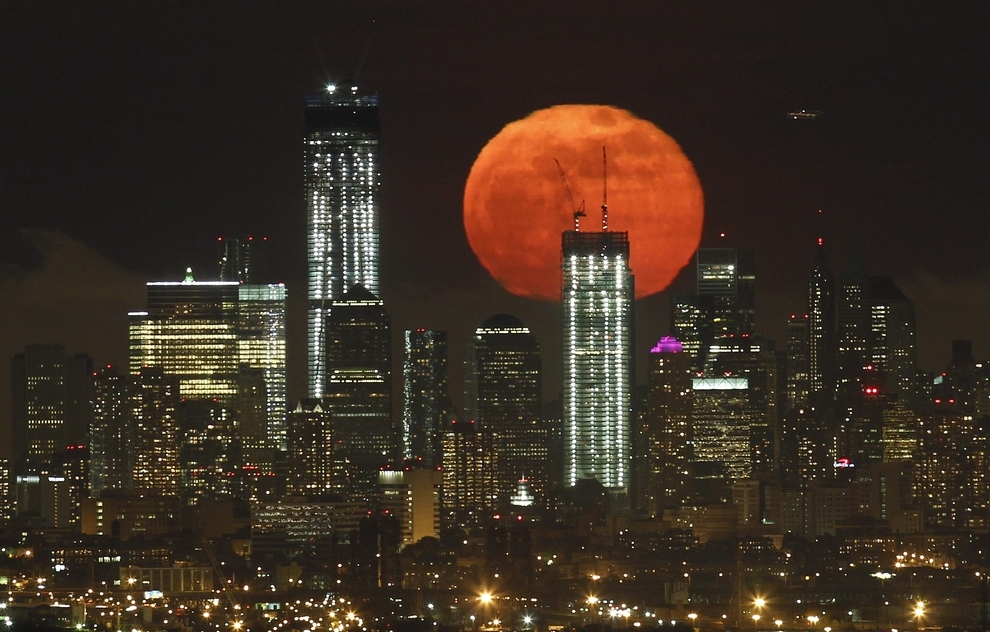 Memorial Freedom Tower Rising from Ground Zero Against a Supermoon in 2012