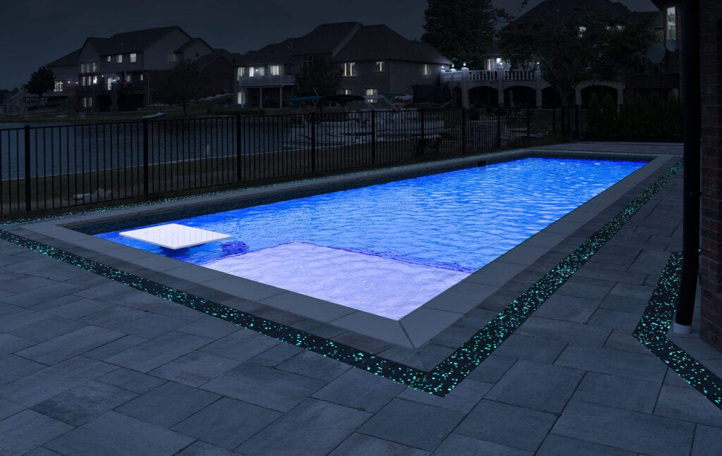 Swimming pool rendering showing off GlowPath Pavers at night