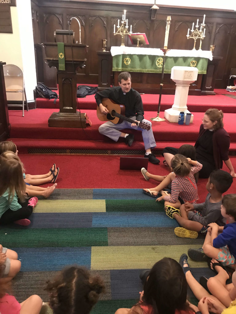 Kids in chapel singing together.