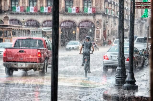 Person riding bike in the rain