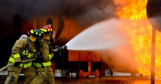 Firefighters taming fire