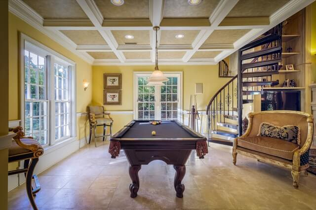 Room with billiards table