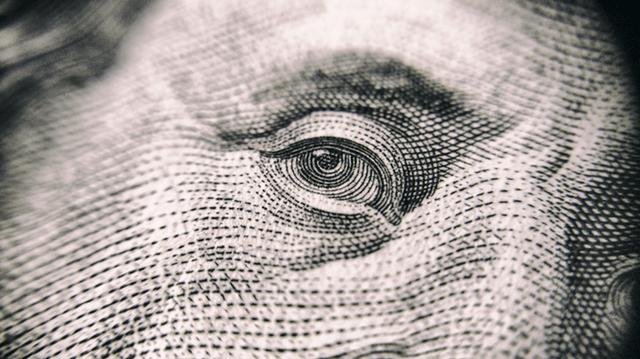 Closeup of Benjamin Franklin on $100 bill no win no fee lawyer