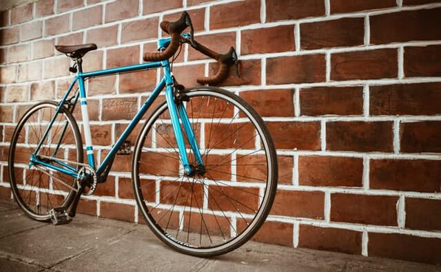 bicycle against brick wall