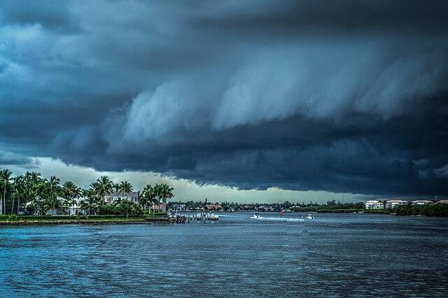 hurricane preparation tips storm cloud over miami
