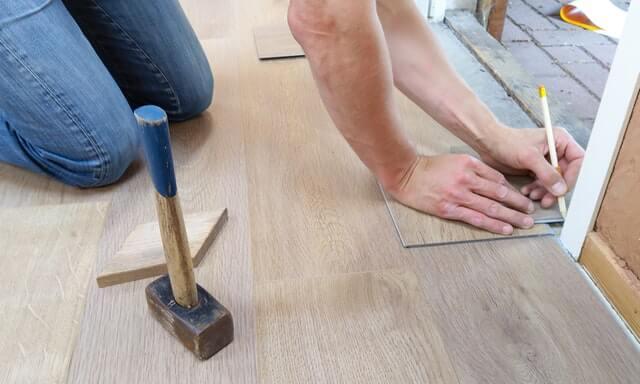 assignment of benefits - carpenter working on floor