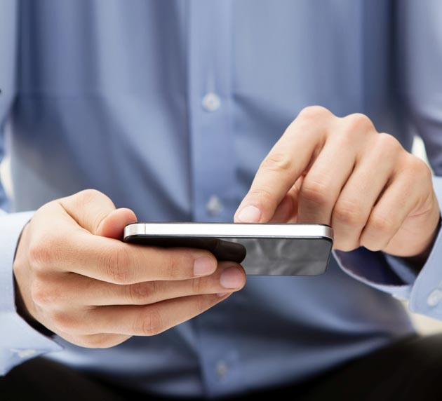Close-Up of a Person's Hands on a Smart Device