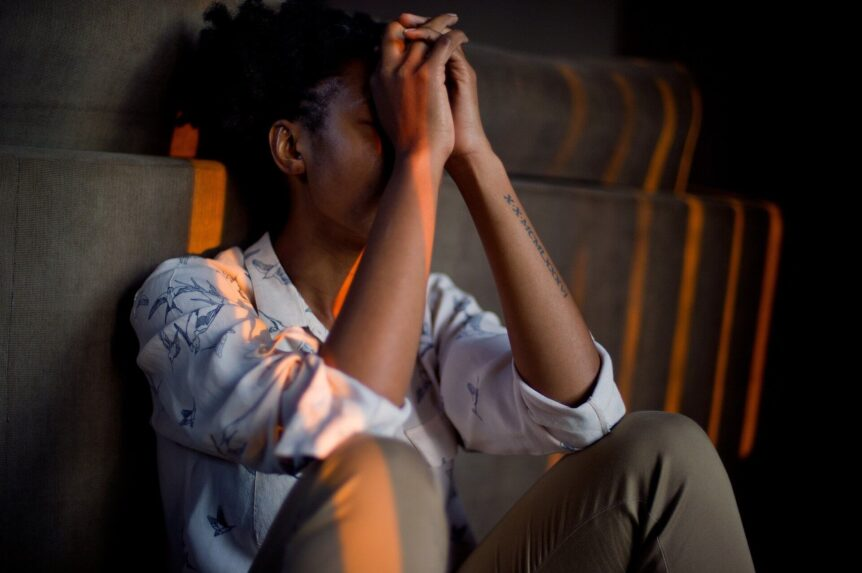 stressed woman can't afford insurance deductible