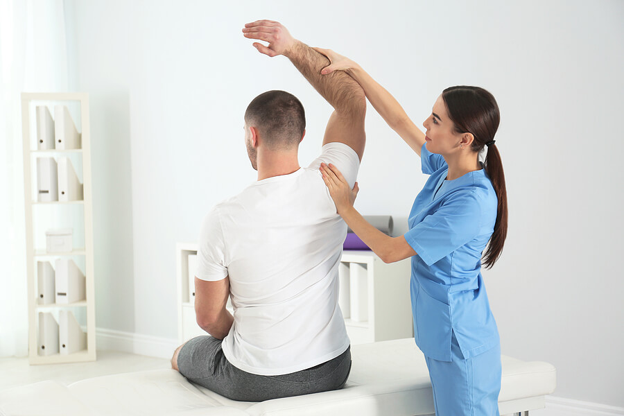 Doctor working with patient for a personal injury lawsuit