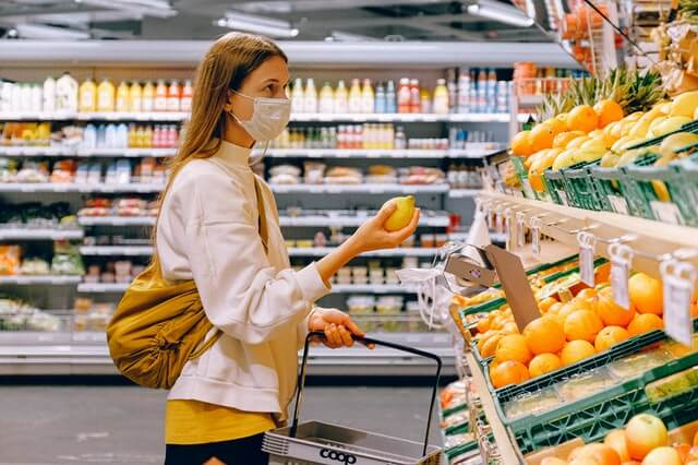 woman shopping before grocery store injuries