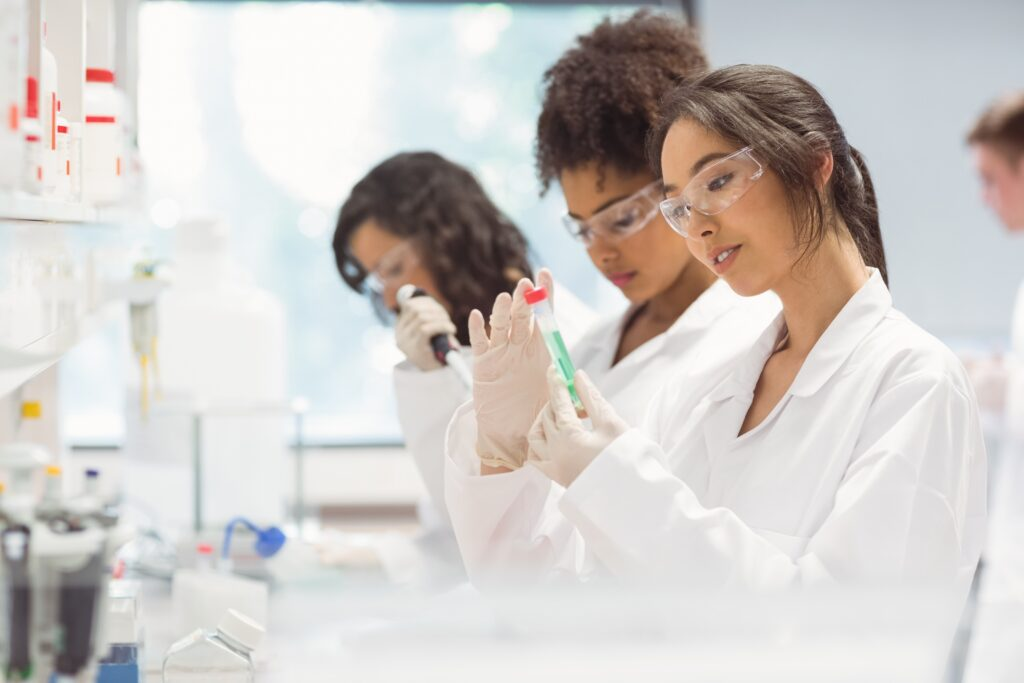 An image of scientists working in a lab. The woman at the forefront has brown hair tied back into a ponytail. As professionals, founding memberships would be perfect for them.