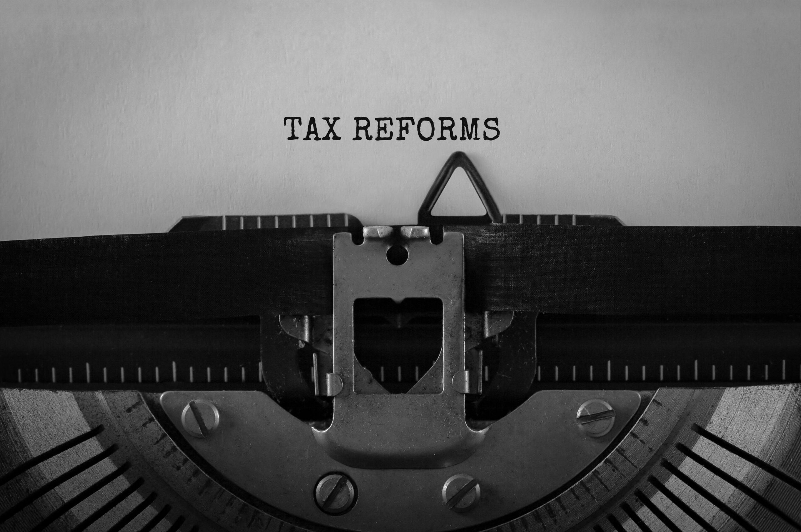 Text Tax Reforms typed on retro typewriter