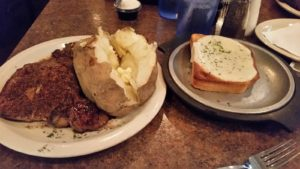 Capers Delmonico with Baked Potato & Garlic Bread
