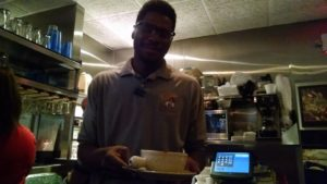 Our helpful server, Nathan, at Capers
