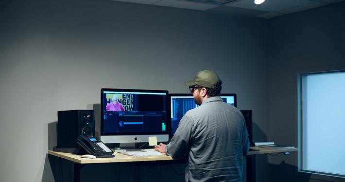 Matt Conrad editting digital video at picture this media