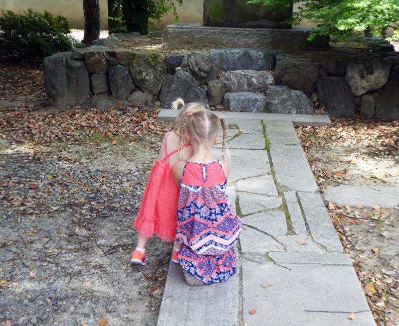 Our two little girls at the temple grounds in Japan