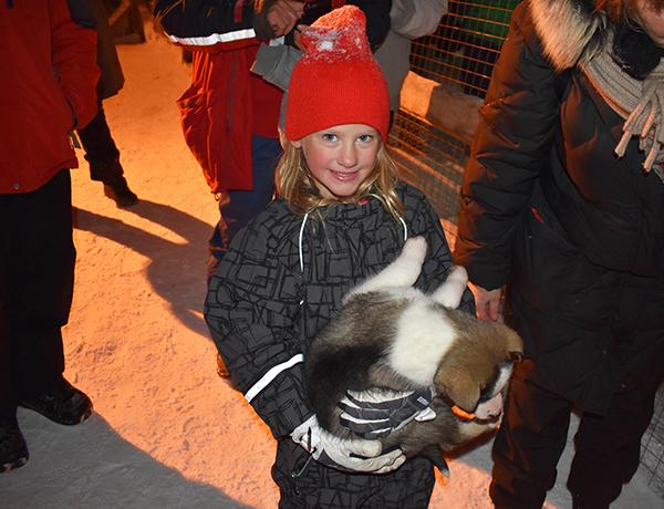Girl holding Husky Puppy
