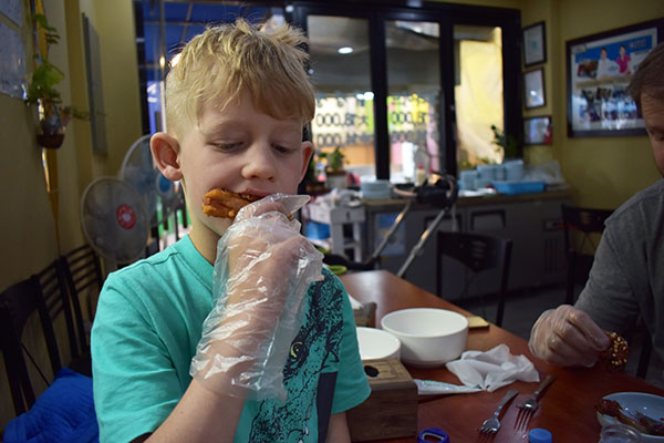 Our son eating Dakgangjeong