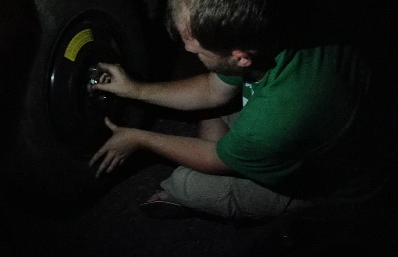 Changing a Tire in Panama on the side of the road