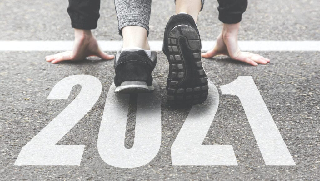 running shoes on pavement 2021