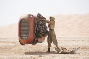 Rey hops onto her horse-sized speeder