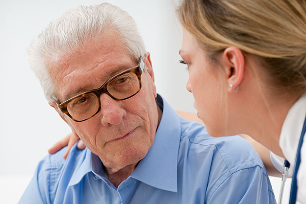 caregiver giving compassionate care to senior man