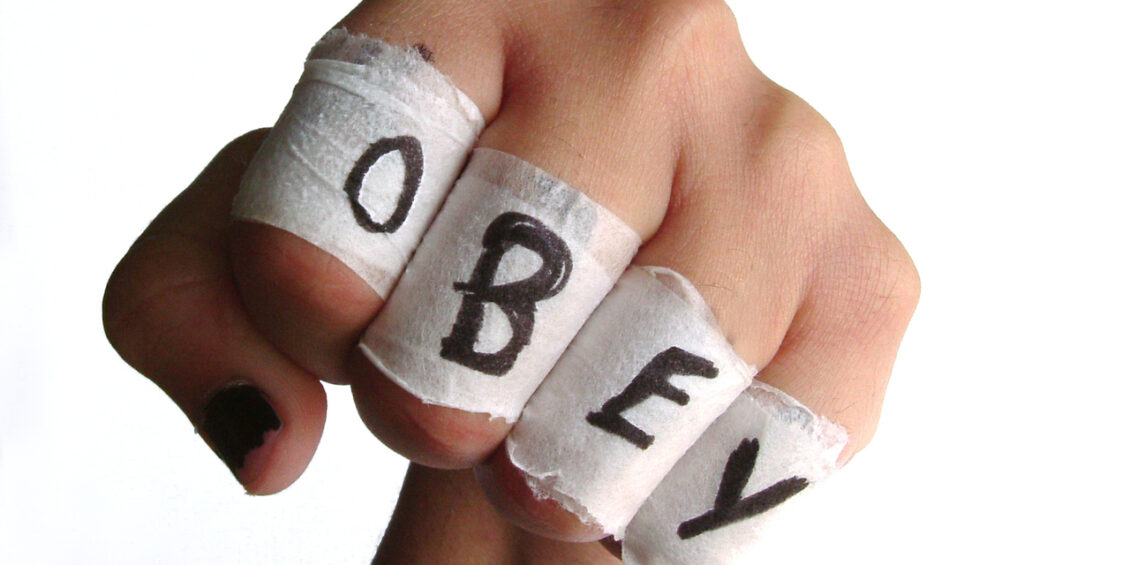 fist with OBEY word