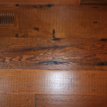 Close up of douglas fir rustic rough sawn reclaimed wood floor