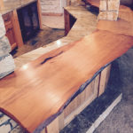 Shiny reclaimed wood table top by Manomin Resawn Timbers