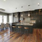 Kitchen with dark weathered antique wood flooring
