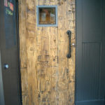 Yellow hand hewn barn door