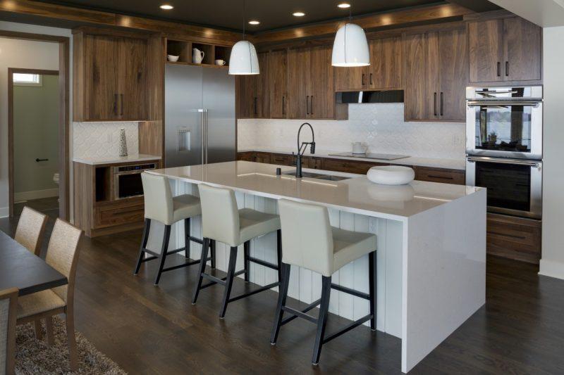 modern kitchen with dark cabinets by sustainable 9