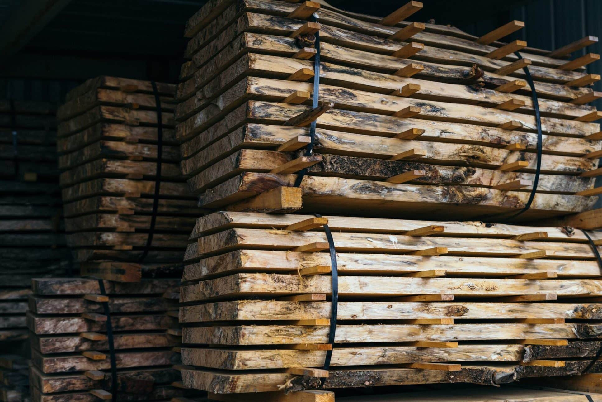 Stack of reclaimed wood timbers.