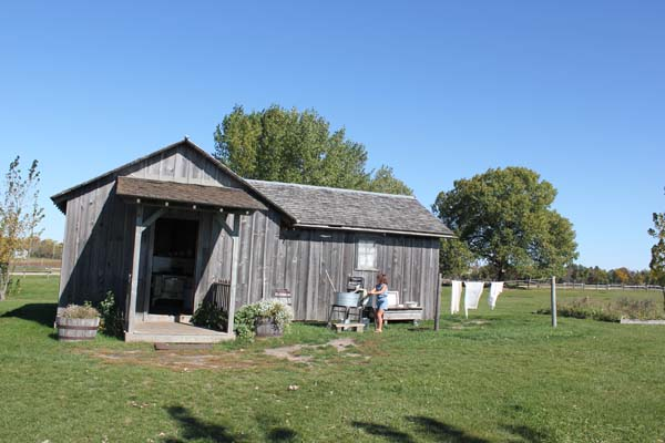Ingalls Homestead in S.D. - This is their house, with P doing the laundry!