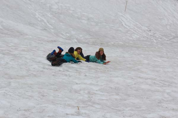 Sledding on plastic on Mt. Tongariro