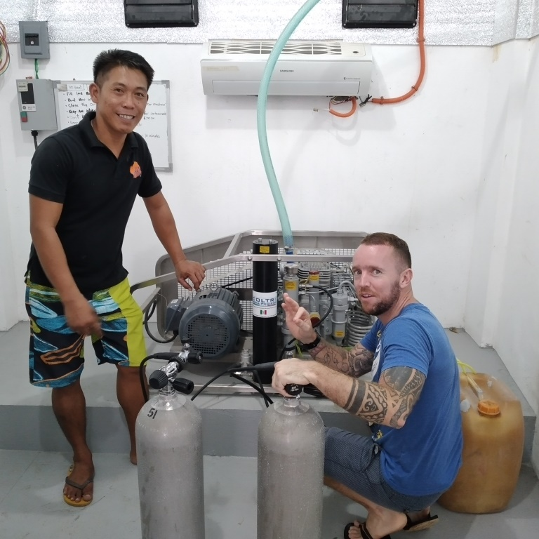 Dive shop manager Conan, and LLV Divers team member Diony, preparing to hit the water running when diving commences.