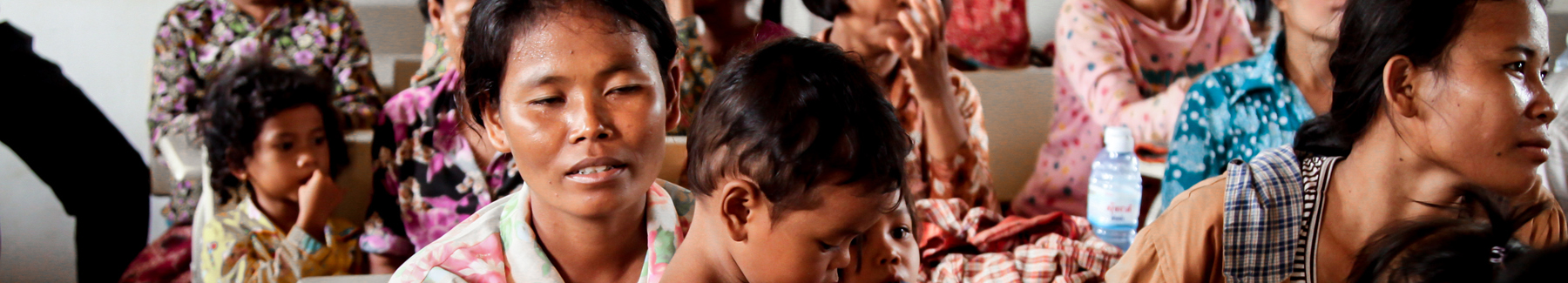Women participate in a reproductive health voucher program.