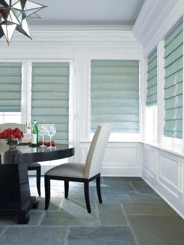 dining space, surrounded by windows with shades