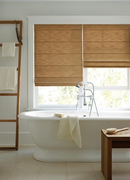 window over a bathrub in a bathroom