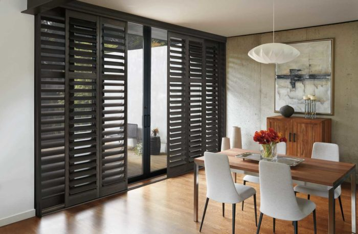 shutters separating dining space from outside