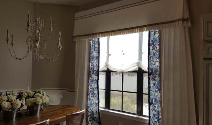window with multiple layers of curtains