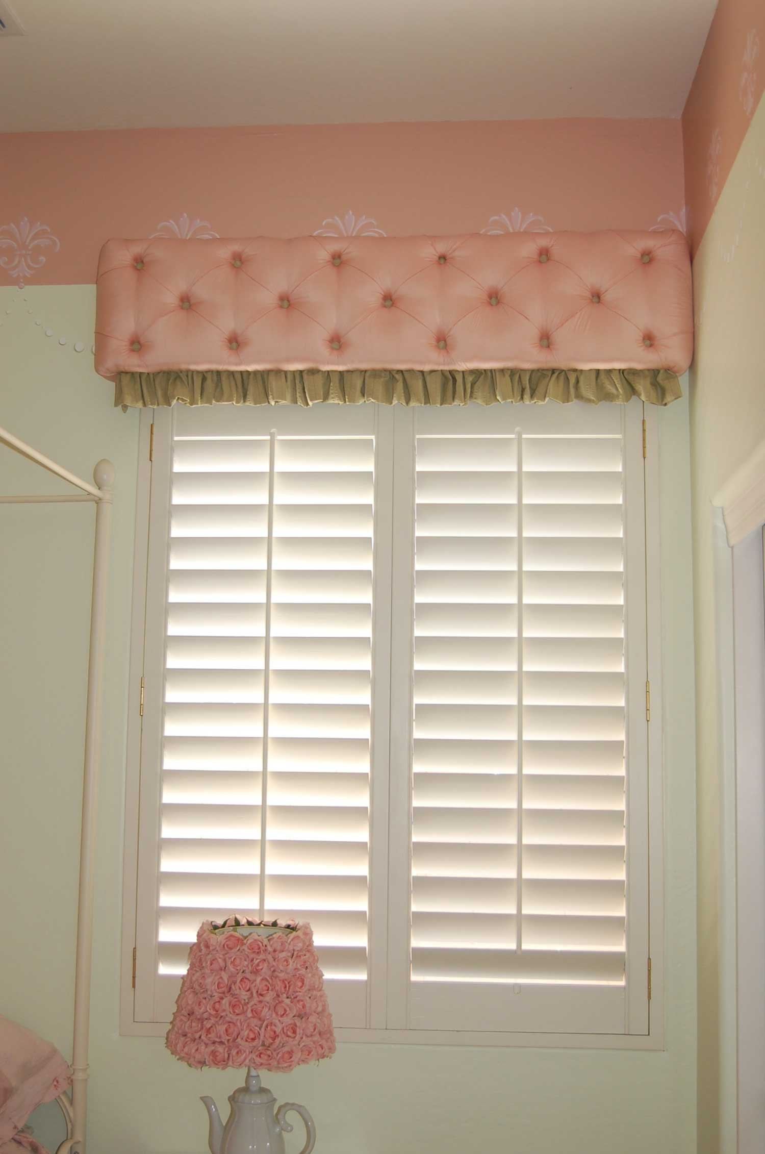 Button tufted Cornice with Ruffle over a shaded window