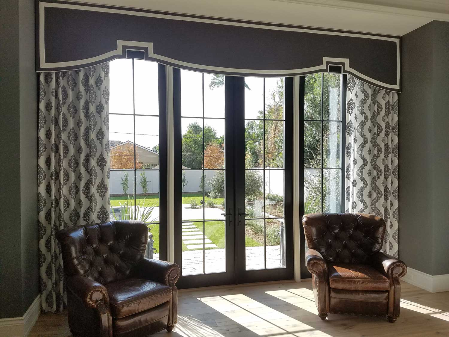 How to care for your curtains in Gilbert - Cornice Box with drapes over large french windows in the living room