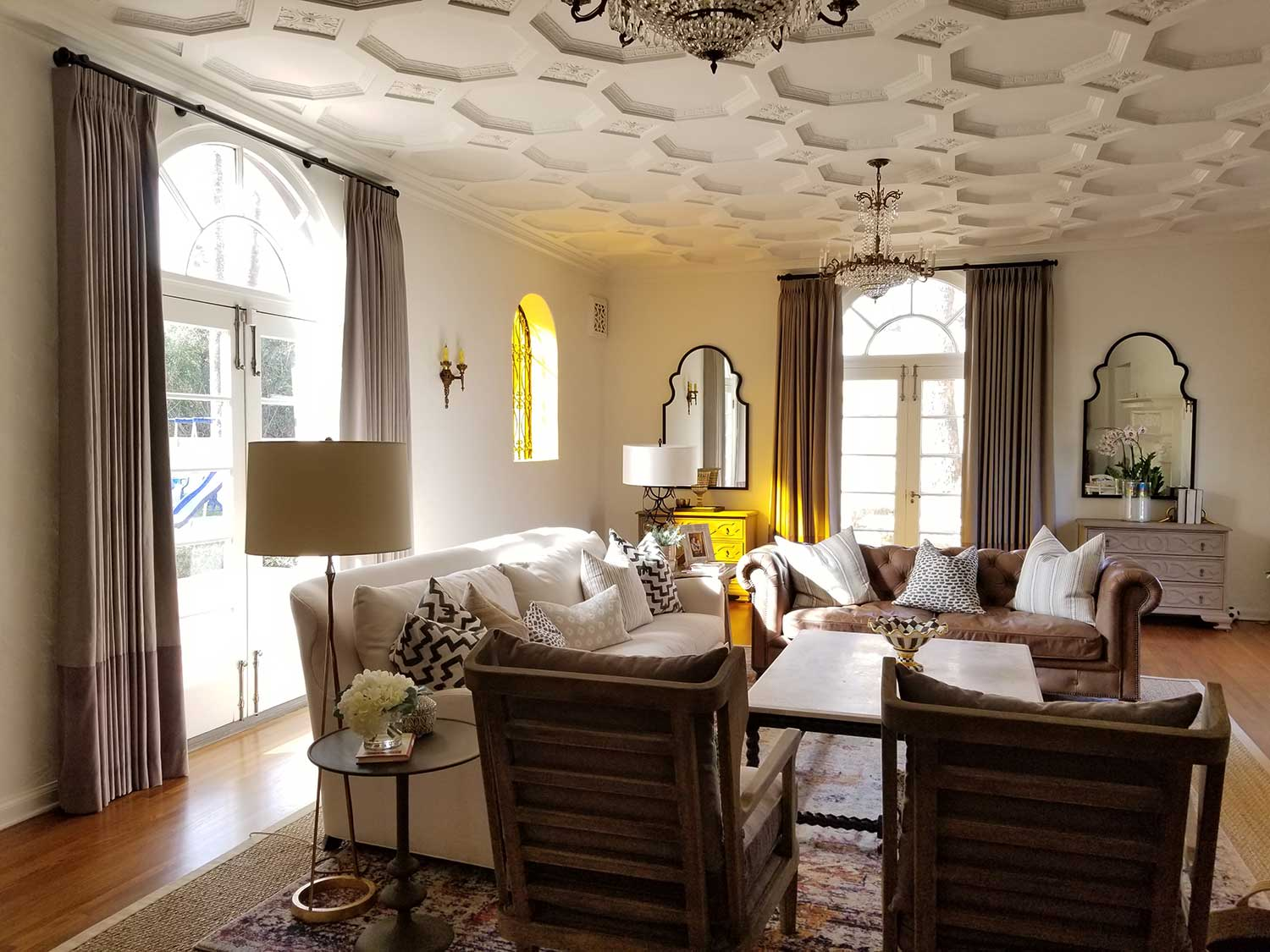 A living room with a honey comb patterned ceiling