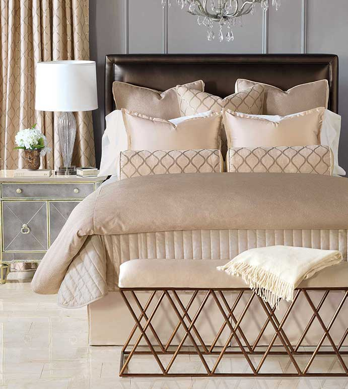 lot of pillows and comforter on a bed